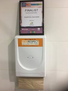 recycled paper hand towel dispenser mounted on wall